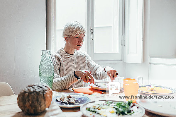 Woman having lunch at home
