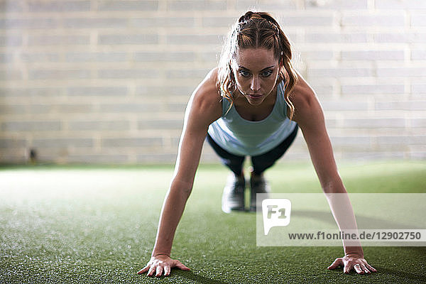Woman doing plank in gym