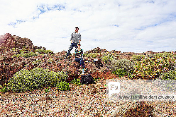 Mature tourist couple in rugged landscape  portrait  Las Palmas  Gran Canaria  Canary Islands  Spain