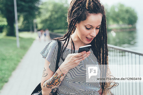 Woman using mobile phone in park