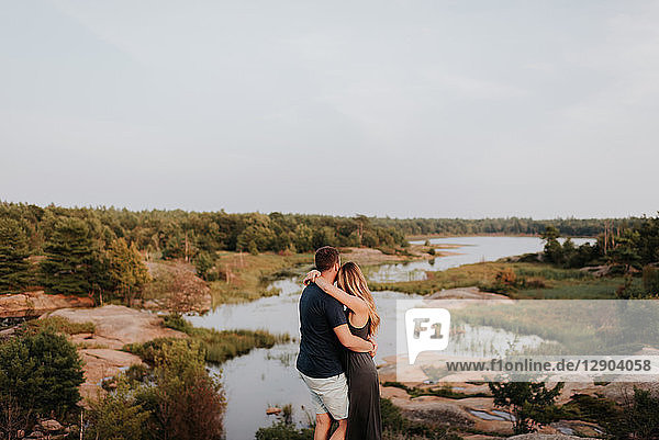 Couple enjoying view of river  Algonquin Park  Canada