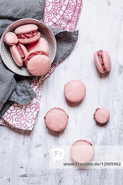 Pink macarons filled with raspberry buttercream
