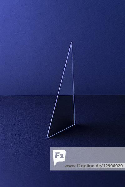 Triangle shaped mirror on dark blue ground  3D Rendering