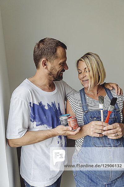 Pregnant couple about to paint their home