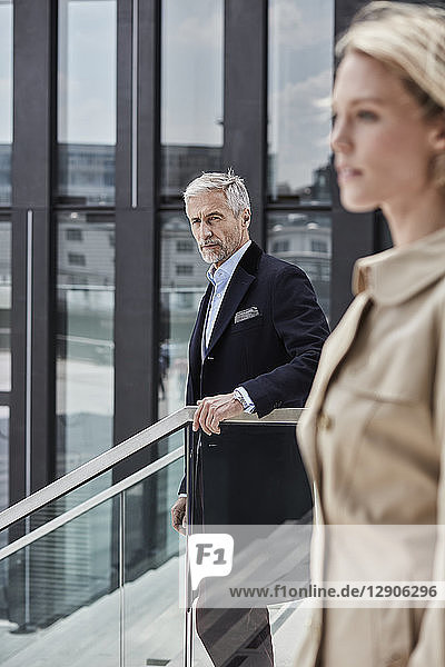 Germany  Duesseldorf  portrait of mature businessman standing on stairs outdoors