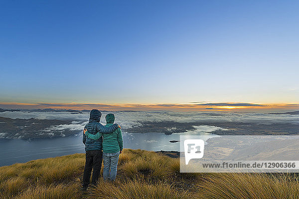 New Zealand  South Island  Wanaka  Otago  Couple on Coromandel peak at sunrise