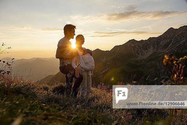 Germany  Bavaria  Oberstdorf  family with little daughter on a hike in the mountains at sunset
