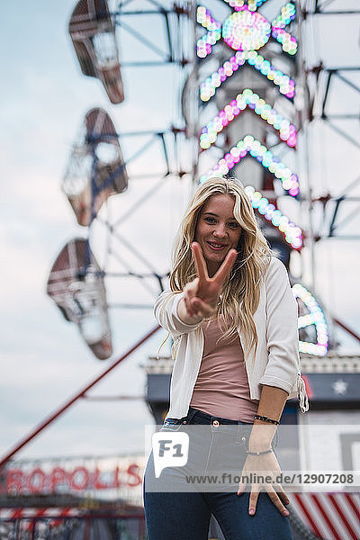 Portrait of smiling young woman on a funfair