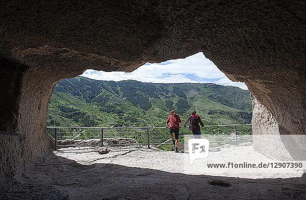 Georgia,  Samtskhe-Javakheti,  Tourists at cave city Vardzia