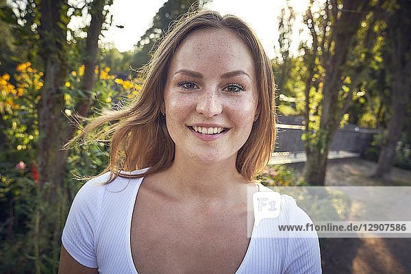 Portrait of a smiling  pretty woman in summer