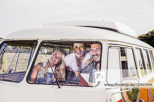 Happy friends inside van