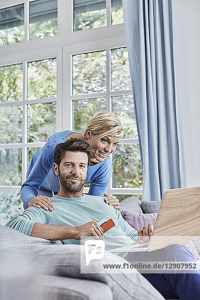 Portrait of couple at home shopping online