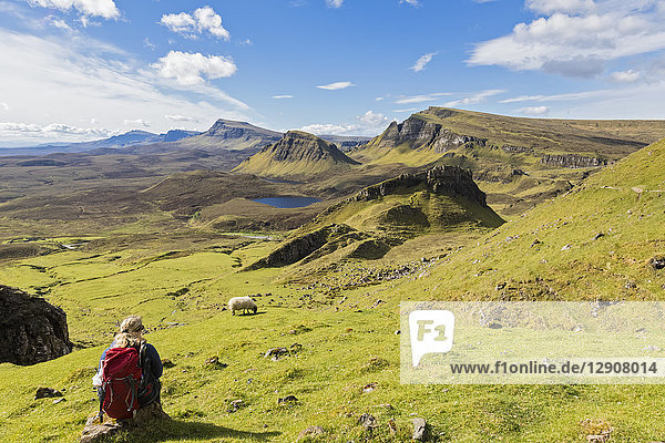 UK  Scotland  Inner Hebrides  Isle of Skye  Trotternish  Quiraing  hiker looking towards Loch Cleat