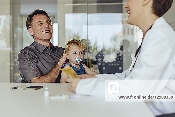 Father and son consulting a pedeatrician