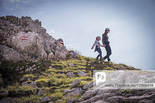 Austria  Salzburg State  Loferer Steinberge  mother and daughter on a hiking trip in the mountains