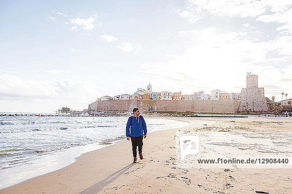 Italy  Molise  Termoli  young man walking at the beach