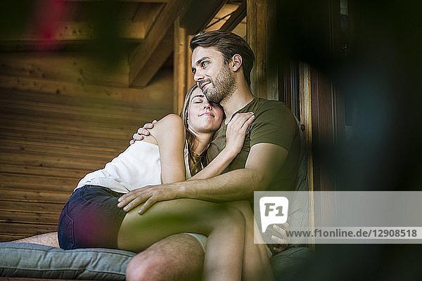 Happy couple hugging and relaxing on balcony