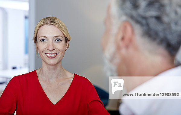 Portrait of smiling young woman with mature colleague in office