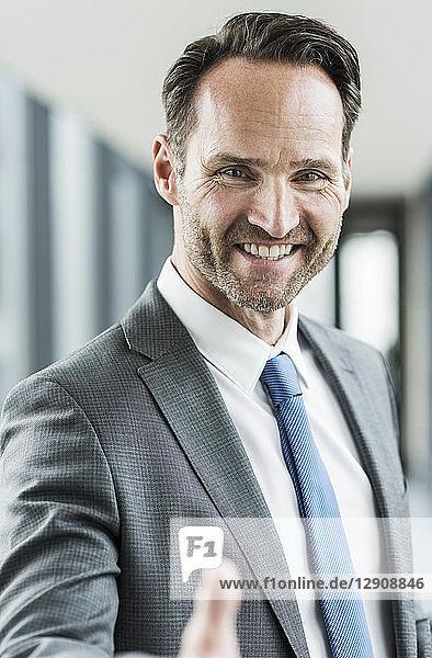 Portrait of smiling businessman shaking hands
