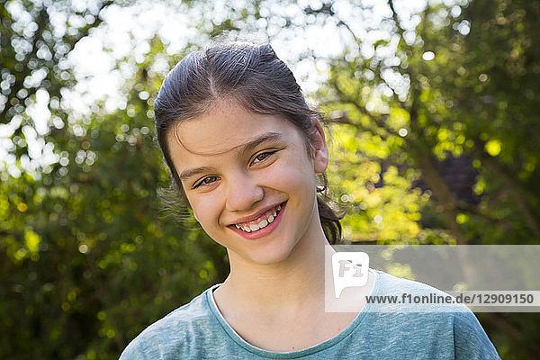 Portrait of smiling girl in the garden