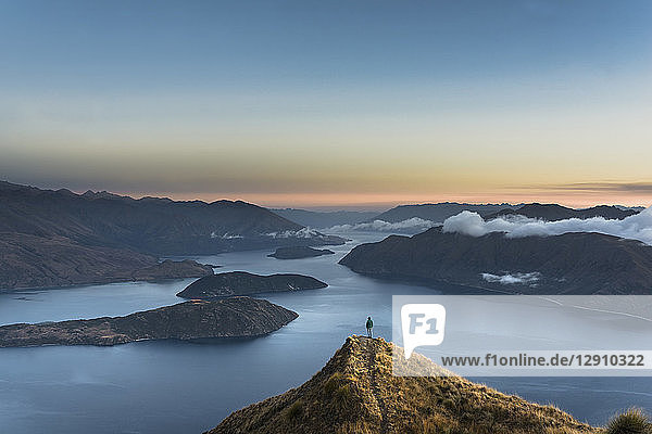 New Zealand  South Island  Wanaka  Otago  Woman on Coromandel peak at sunrise
