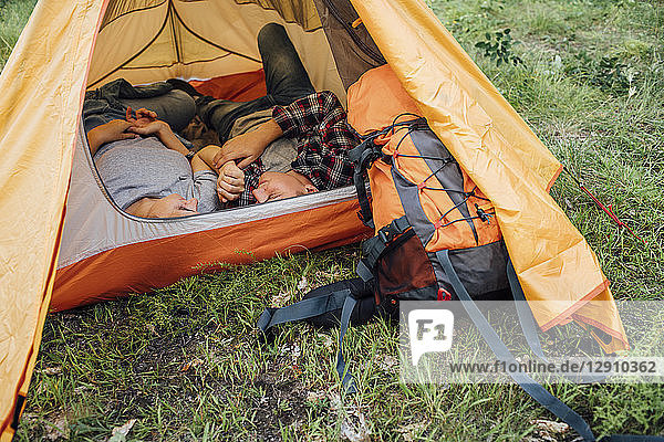 Young couple napping in tent