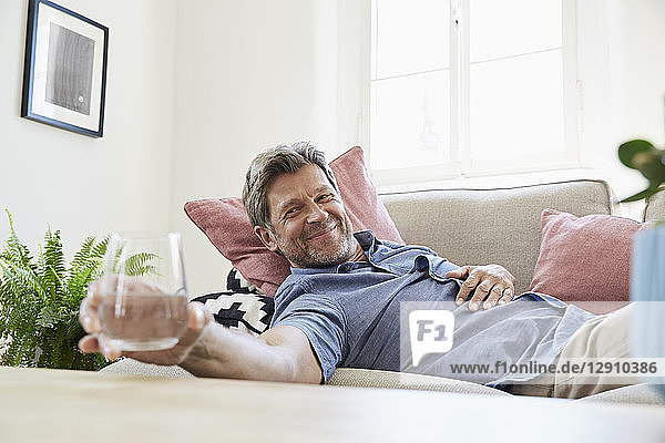 Man relaxing at home  drinking water