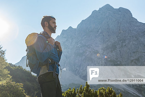 Austria  Tyrol  Hiker with backpack hiking in the mountains