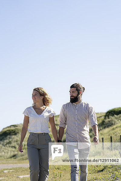 Young couple taking a walk in the dunes