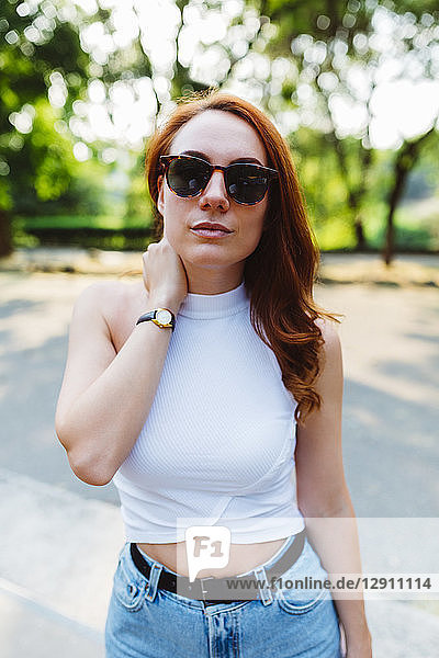 Portrait of redheaded woman wearing sunglasses