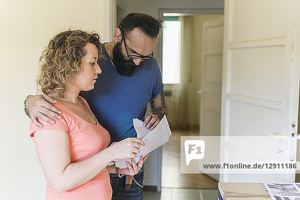Couple examining contract of new home