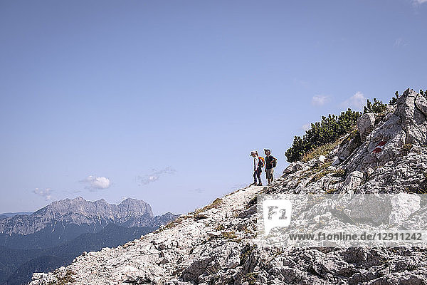 Austria  Salzburg State  Loferer Steinberge  brother and sister on a hiking trip in the mountains
