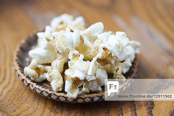 Wood bowl of popcorn