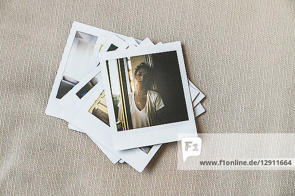 Stack of instant photos of young woman