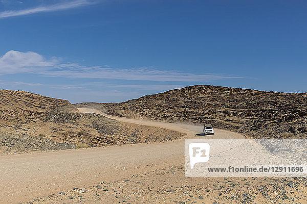 Africa  Namibia  Namib desert  Naukluft National Park  off-road vehicle on gravel road