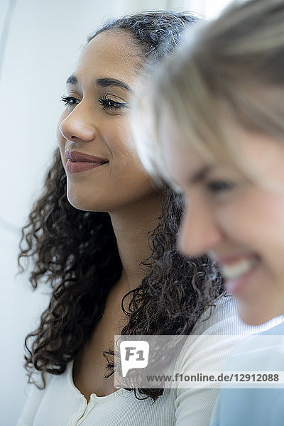 Portrait of two female friends  laughing