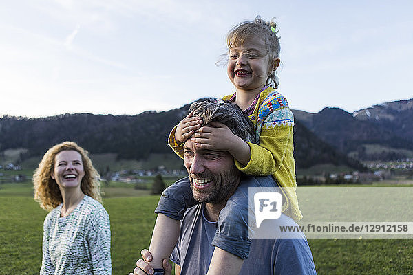 Austria  Tyrol  Walchsee  happy family hiking on an alpine meadow