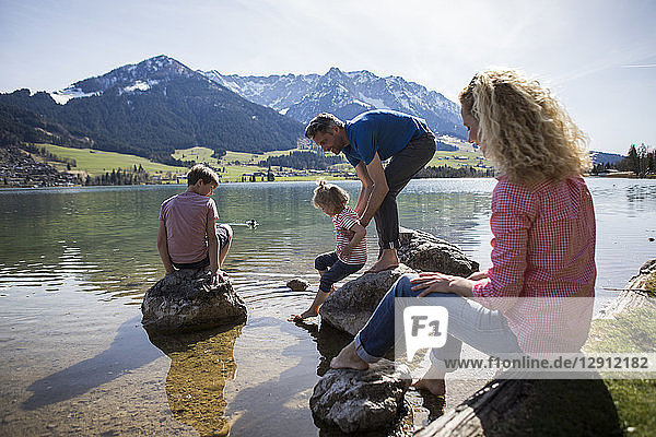 Austria  Tyrol  Walchsee  happy family at the lake