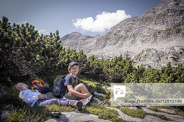 Austria  Salzburg State  Loferer Steinberge  brother and sister resting on a hiking trip in the mountains