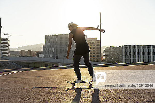 Young man riding skateboard in the city