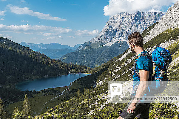 Austria  Tyrol  Young man hiking in the maountains at Lake Seebensee