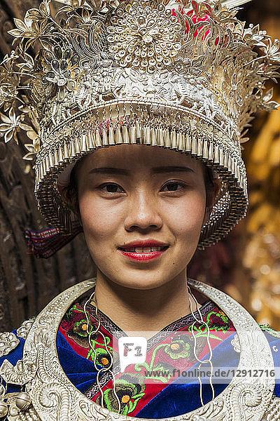 China  Guizhou  portrait of a young Miao woman wearing traditional dress and headdress