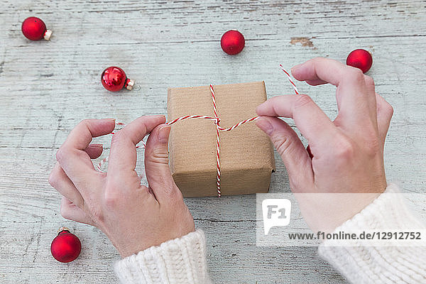 Woman's hands wrapping Christmas present