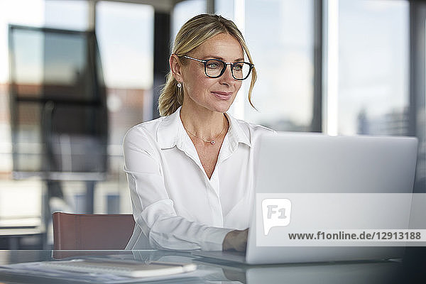 Businesswoman working in office  using laptop