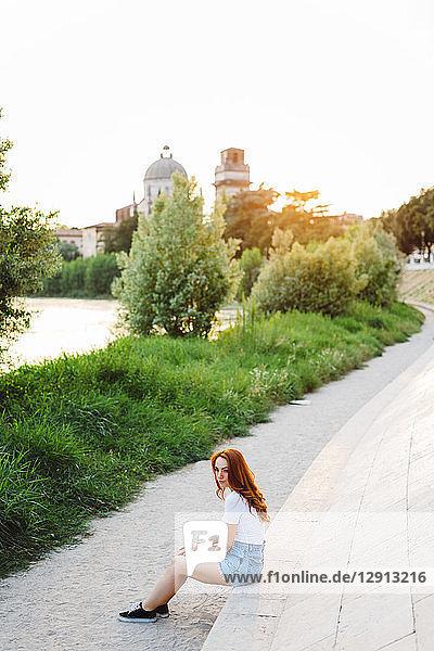 Italy  Verona  redheaded woman relaxinging at evening twilight