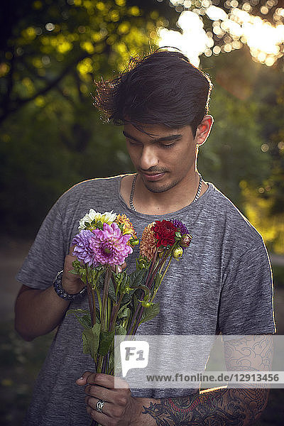 Young man waiting with a bunch of flowers