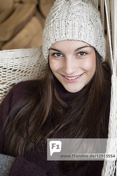 Portrait of smiling young woman wearing wooly hat i