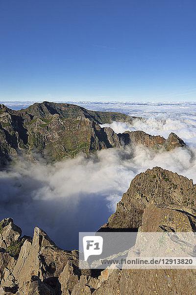 Madeira  Pico Ruivo  Sea of clouds below mountain peaks seen from Pico do Areeiro