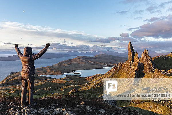 UK  Scotland  Inner Hebrides  Isle of Skye  Trotternish  tourist on peak near The Storr