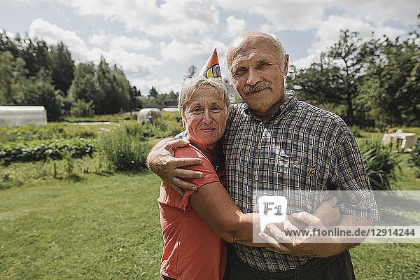 Portrait of senior couple embracing each other in the garden